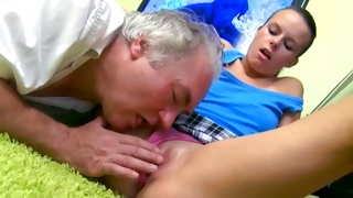 Aged guy is pleasuring this babe's shaved tasty pussy hole