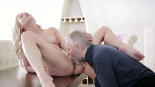 Aged dude is hammering this blonde babe's shaved pussy