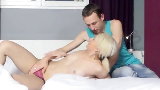 Blonde whore on porn video gets her boobs grabbed