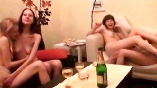 Four sexually attractive bitches are drinking the alcohol and kissing 'em