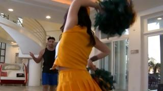 Dude is watching on sexy cheerleader is dancing