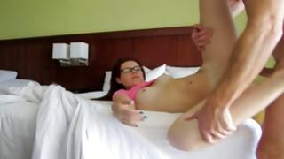 Vulgar young slut is posing hot on the bed