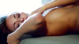 Hotie babe lying there and pleasuring her shaved pussy