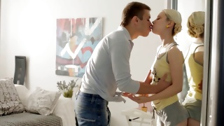 Teen blonde with small tits staring at her guy passionately